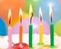 close-up of birthday cake with colorful candles